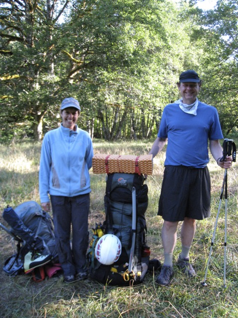 Mel and I on breaking our first camp, comparing the various sizes of our packs. His weighed more than I did.