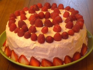 My famous angel food cake with pink clouds and strawberries, our traditional cake during all birthdays.
